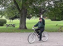 Father Herttna, on his bike